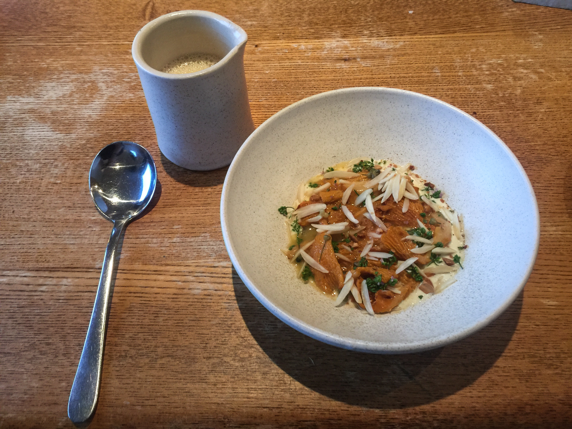 Chanterelle mushrooms, almonds and fresh marjoram with potato broth